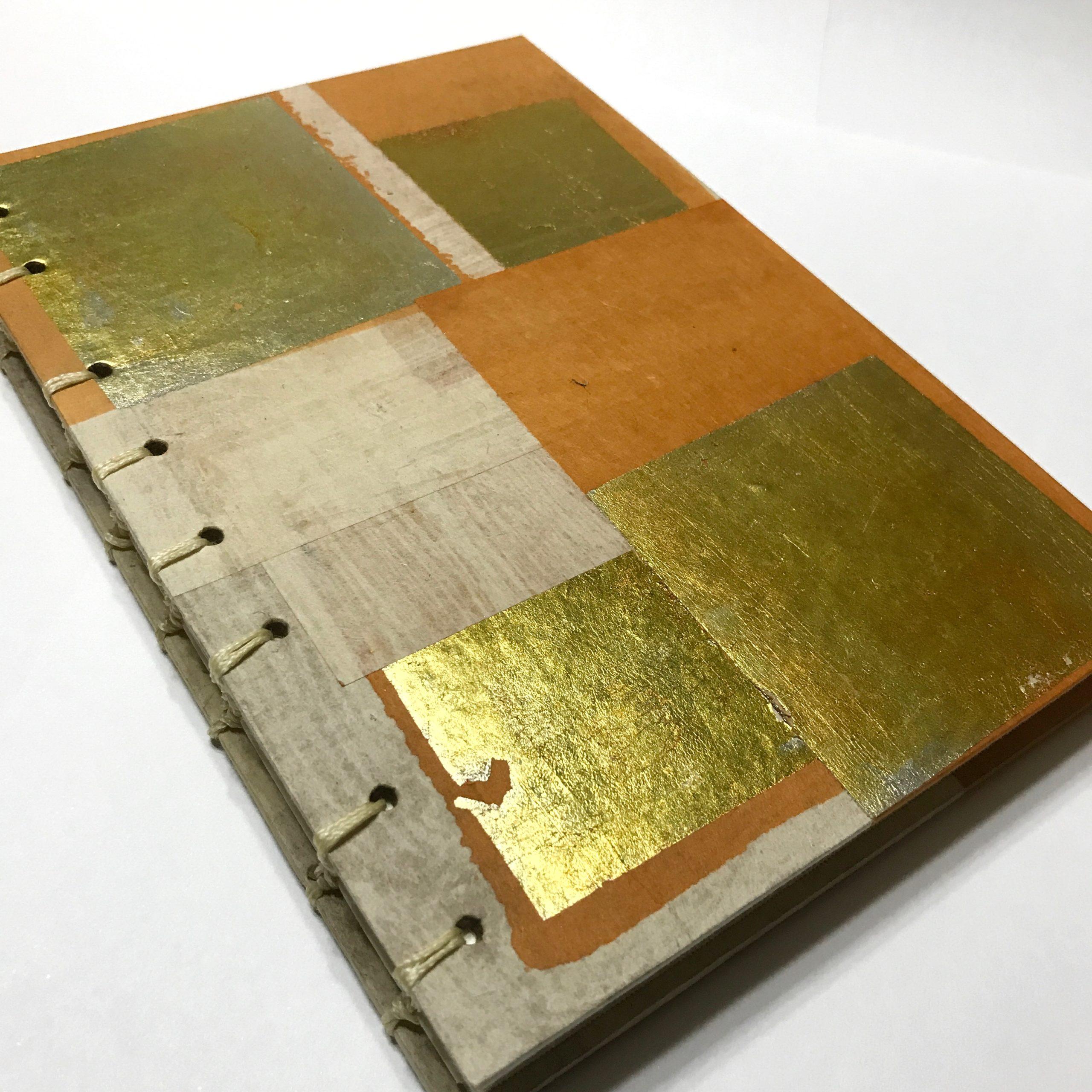 Cover of sketchbook with gold leaf and orange design