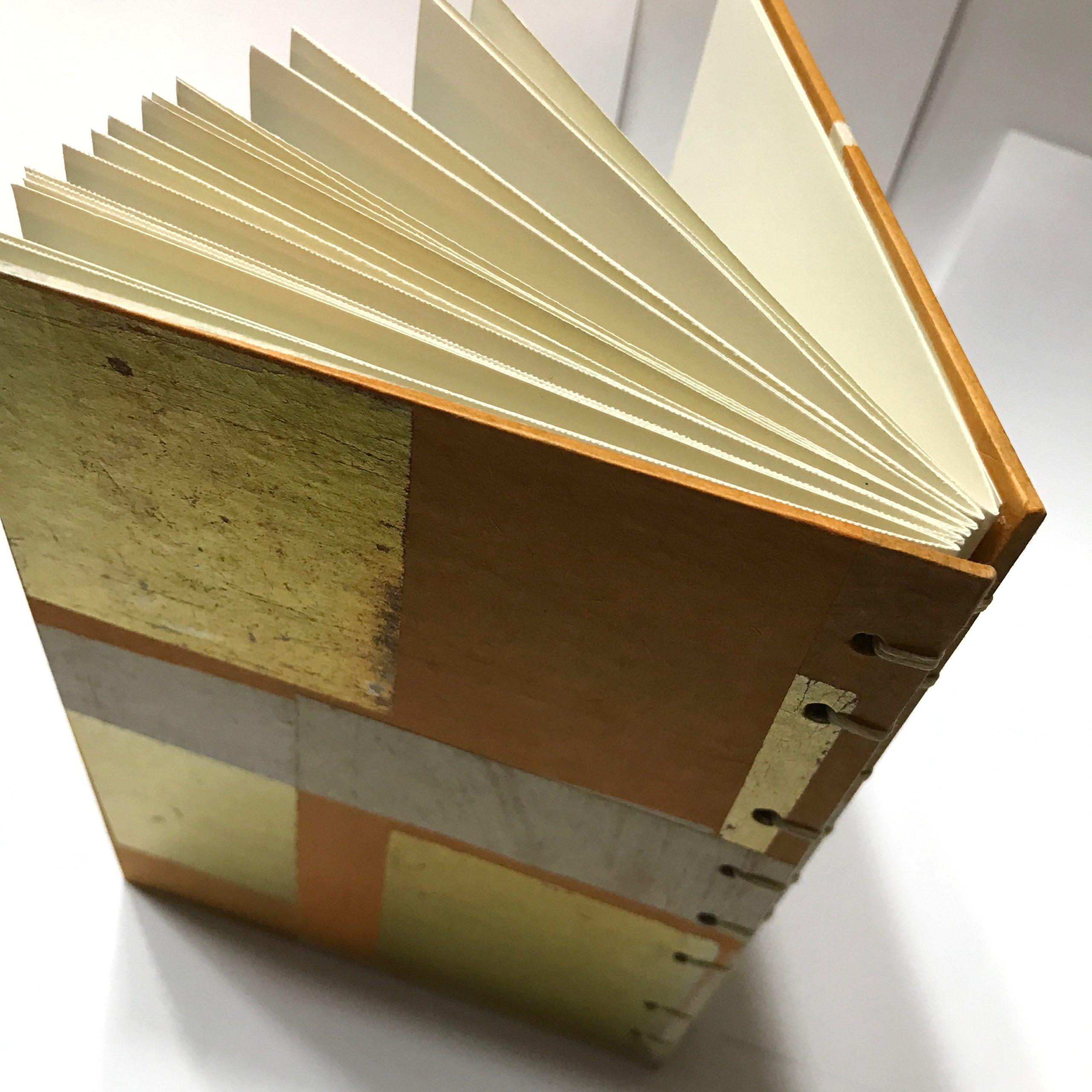 Back cove of sketchbook with gold leaf and orange design