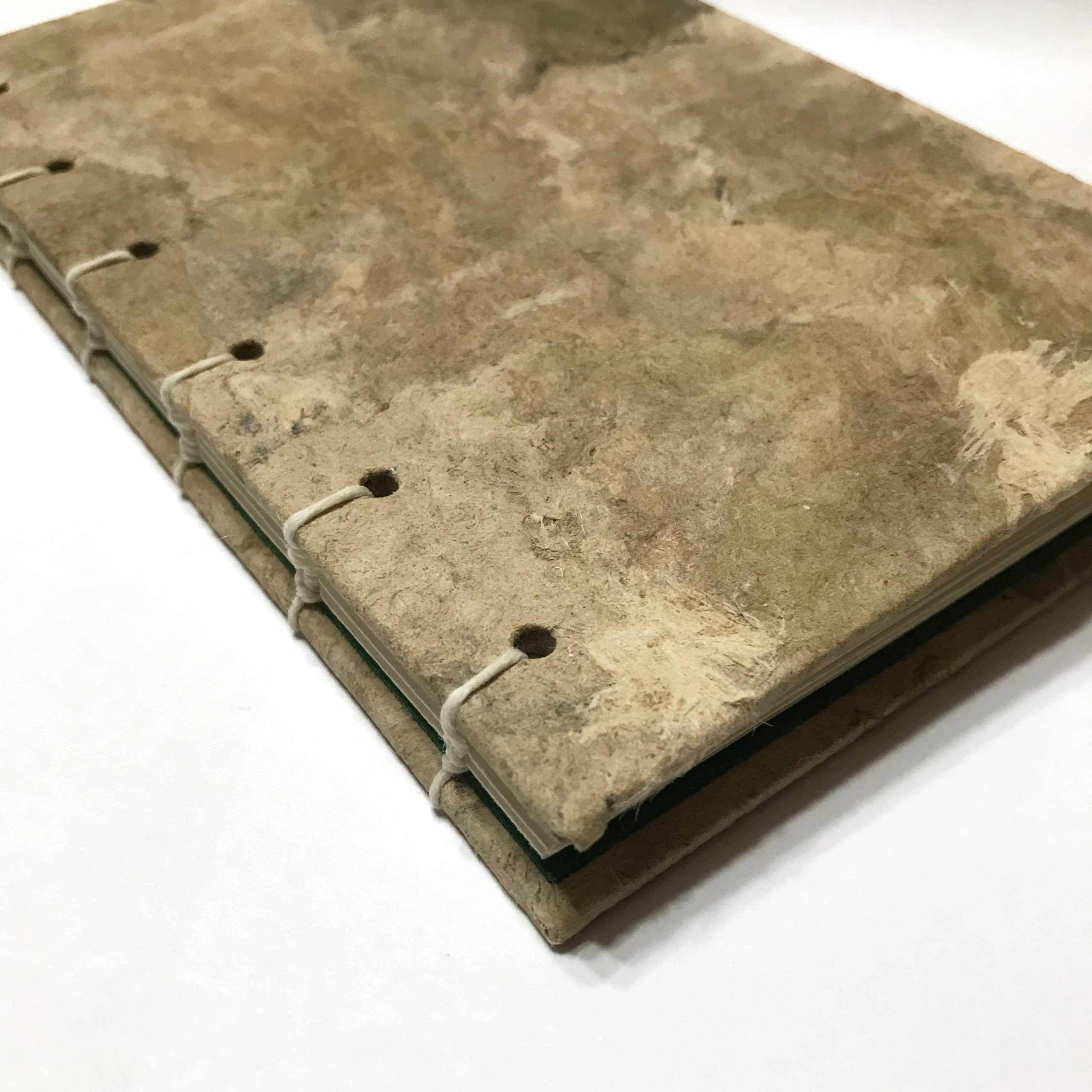 Closeup of cover of natural bark cover sketchbook